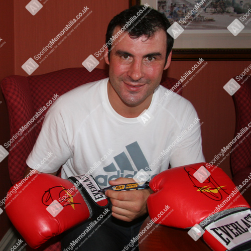 Joe Calzaghe signing autograph on boxing glove