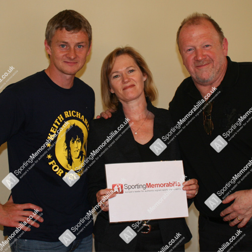 Manchester United legend Ole Gunnar Solskjaer with A1 Sporting Memorabilia Directors Terry & Freda Baker