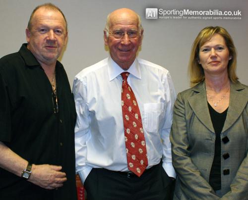 Sir Bobby Charlton with A1 Sporting Memorabilia Directors Terry & Freda Baker