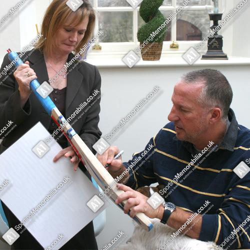 Sir Ian Botham signing Cricket Bat for A1 Sporting Memorabilia