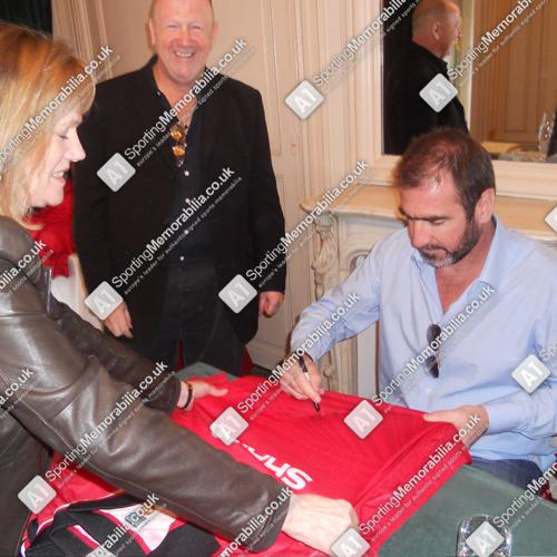 Eric Cantona signing Manchester United shirt