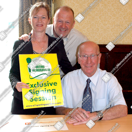 Sir Bobby Charlton with A1 Sporting Memorabilia Directors Terry & Freda Baker