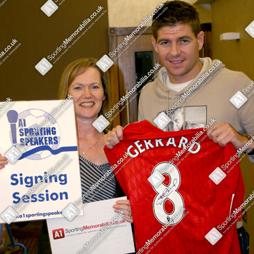 Steven Gerrard signing Liverpool shirts with Freda Baker, Director of A1 Sporting Memorabilia