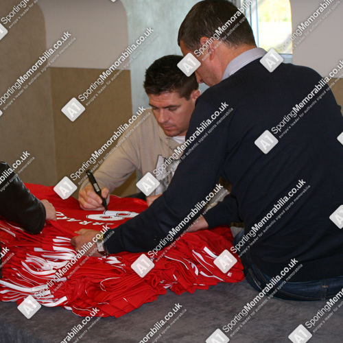 Steven Gerrard hand signing Liverpool shirts exclusively for A1 Sporting Memorabilia