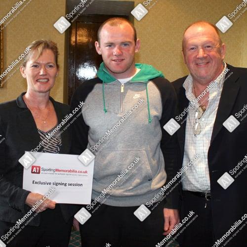 Wayne Rooney with A1 Sporting Memorabilia Directors Terry & Freda Baker
