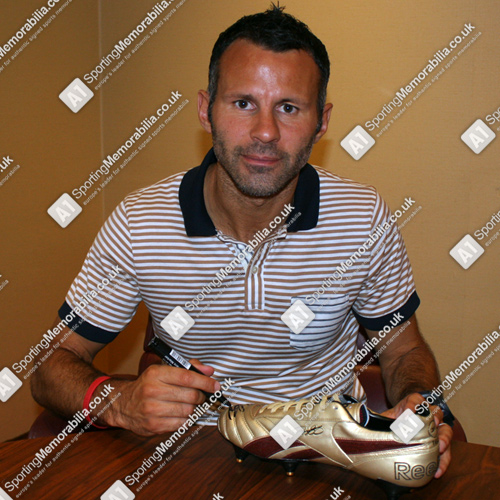 Ryan Giggs signing football boot