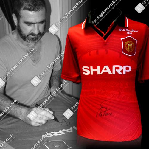 Eric Cantona signing autographed Manchester United shirt