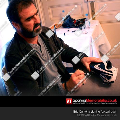 Eric Cantona signing football boot