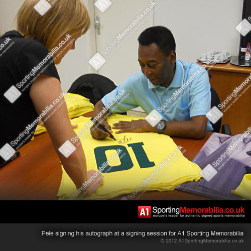 Pele signing his autograph at a signing session for A1 Sporting Memorabilia
