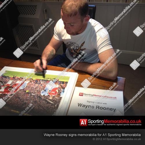 Wayne Rooney signs memorabilia for A1 Sporting Memorabilia