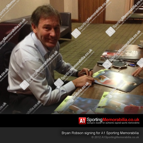 Bryan Robson signing for A1 Sporting Memorabilia