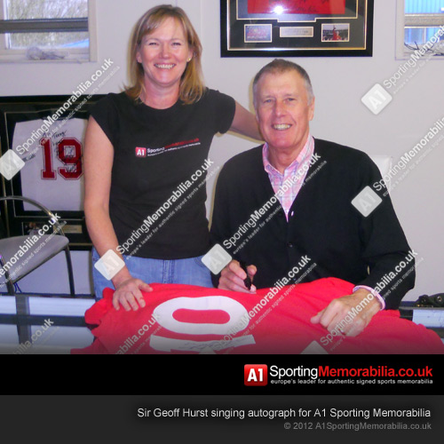 Sir Geoff Hurst singing autograph for A1 Sporting Memorabilia
