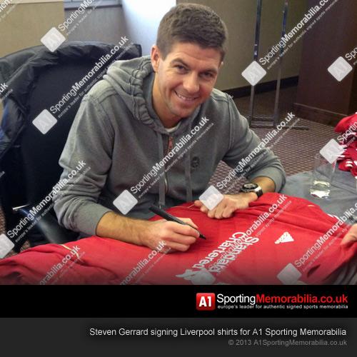 Steven Gerrard signing Liverpool shirts for A1 Sporting Memorabilia