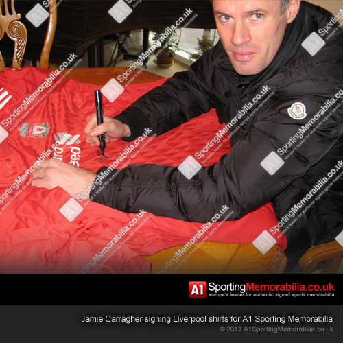 Jamie Carragher signing Liverpool shirts for A1 Sporting Memorabilia