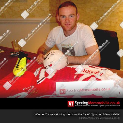 Wayne Rooney signing memorabilia for A1 Sporting Memorabilia