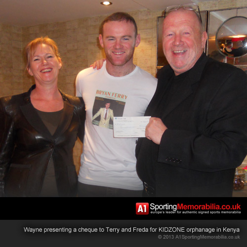 Wayne presenting a cheque to Terry and Freda for KIDZONE orphanage in Kenya
