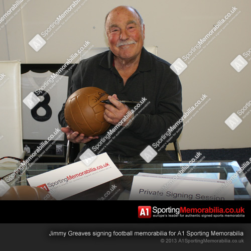 Jimmy Greaves signing football memorabilia for A1 Sporting Memorabilia