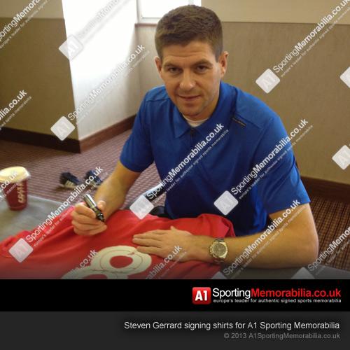 Steven Gerrard signing shirts for A1 Sporting Memorabilia