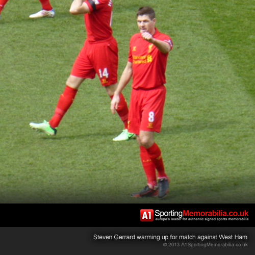 Steven Gerrard acknowledges private box whilst warming up against West Ham