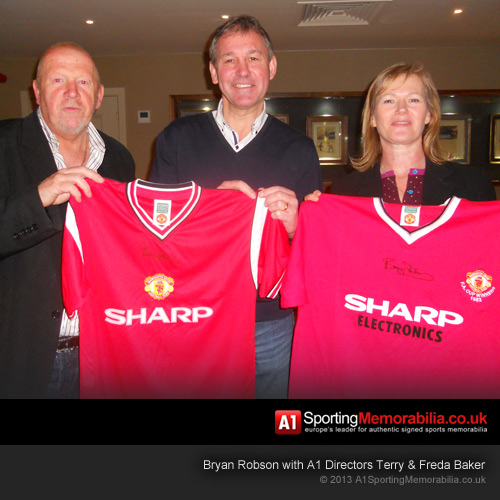Bryan Robson Signing Shirts for A1 Sporting Memorabilia