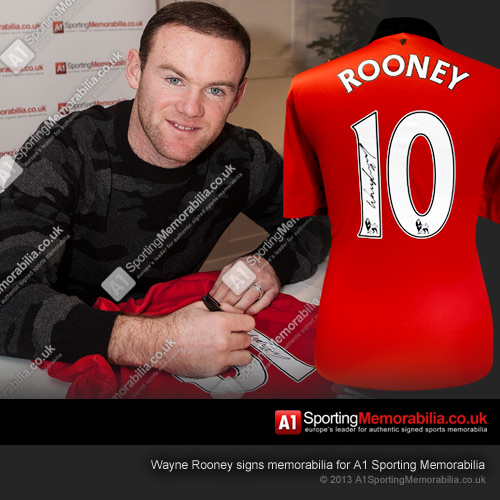 Wayne Rooney signs memorabilia for A1 Sporting Memorabilia
