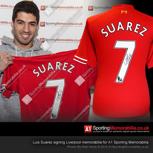 Luis Suarez signing Liverpool memorabilia for A1 Sporting Memorabilia