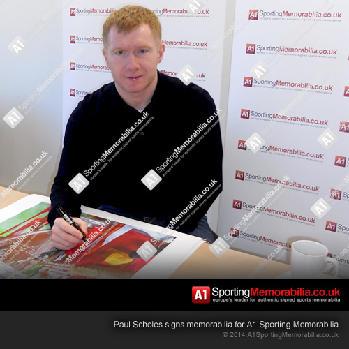 Paul Scholes signs memorabilia for A1 Sporting Memorabilia