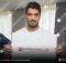 Luis Suarez signing memorabilia for A1 Sporting Memorabilia